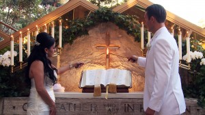 Wayfarers Chapel couple lighting candle at altar