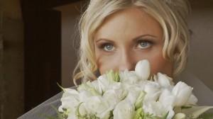 photo of bride looking over her bouquet
