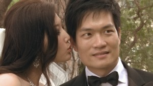 Bride kissing groom during their wedding, scene from video